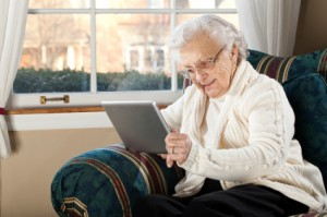 Apps for seniors - Grandmother Using Tablet Computer